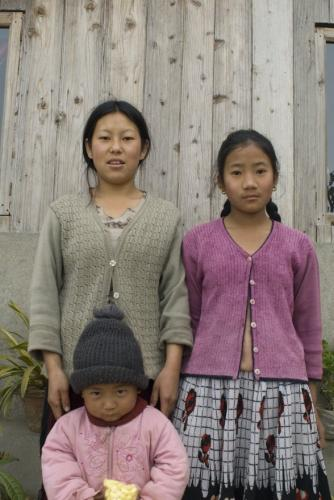 Child with mother and sister sm